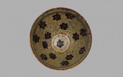 A fine and rare Jizhou bowl with paper-cut plum blossom florets design