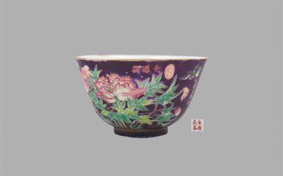 A fine and rare purple ground famille rose 'Dayazhai' tea bowl