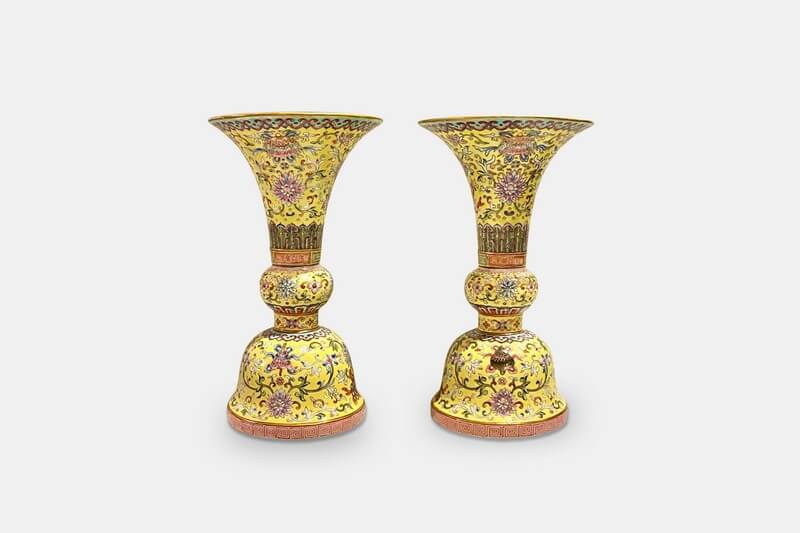 A fine and rare pair of yellow ground famille rose Gu-shaped vases