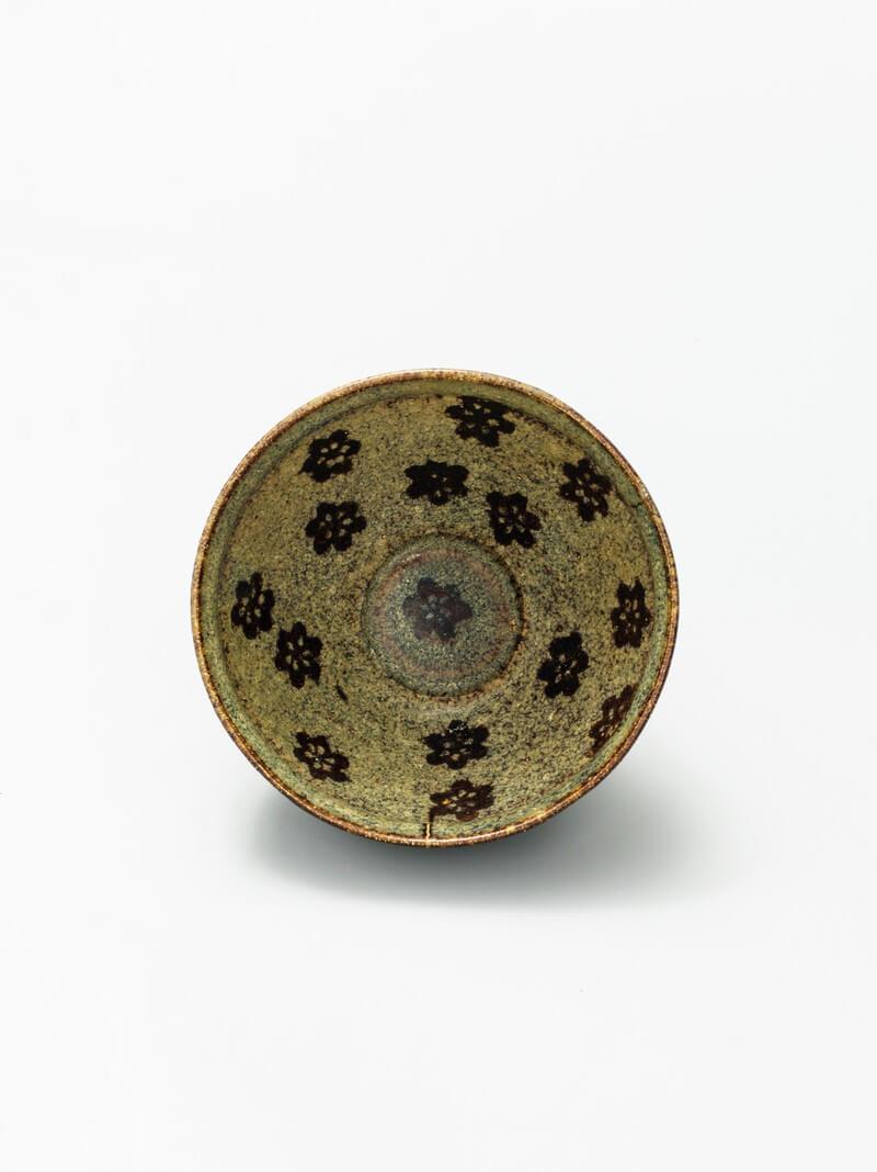 A fine and rare Jizhou paper-cut prunus decorated tea bowl